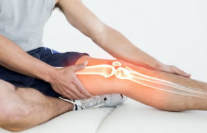 Highlighted knee of injured man